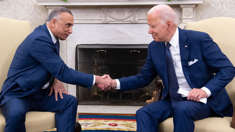 US President Joe Biden shakes hands with Iraqi Prime Minister Mustafa Al-Kadhimi (L) in the Oval Office of the White House in Washington, DC, July 26, 2021. (Photo by SAUL LOEB/AFP via Getty Images)