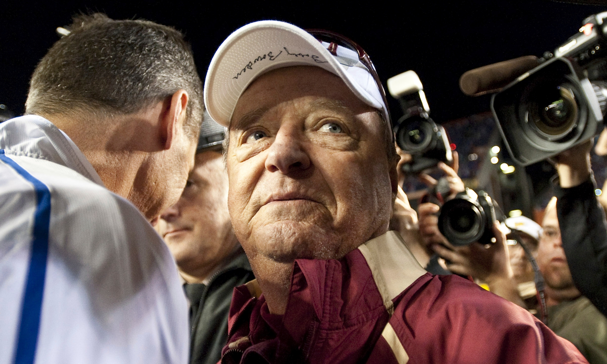 FILE - In this Saturday, Nov. 28, 2009 file photo, Florida State head football coach Bobby Bowden wears a dejected expression as he turns to leave Florida coach Urban Meyer after congratulating Meyer following Florida's 37-10 win over Florida during an NCAA football game in Gainesville ,Fla. The Hall of Fame college football coach Bobby Bowden has died after a battle with pancreatic cancer. Exuding charm and wit, Bowden led Florida State to two national championships and a record of 315-98-4 during his 34 seasons with the Seminoles. In all, Bowden had 377 wins during his 40 years in major college coaching. He was 91 years old. (AP Photo/Phil Sandlin, File)