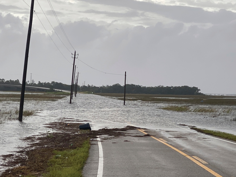 Harrison County W Wittmann Road in Pass Christian, Miss. floods in the early morning of Sunday, Aug. 29, 2021 as a result of the arrival of Hurricane Ida. (Hunter Dawkins/The Gazebo Gazette via AP)