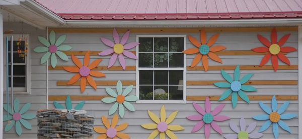 'They make everything so much brighter': Davidson County craftsmen makes wall flowers inspired by late wife