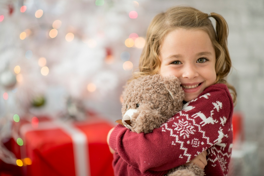 A young girl hugging her new teddy bear (Getty Images)