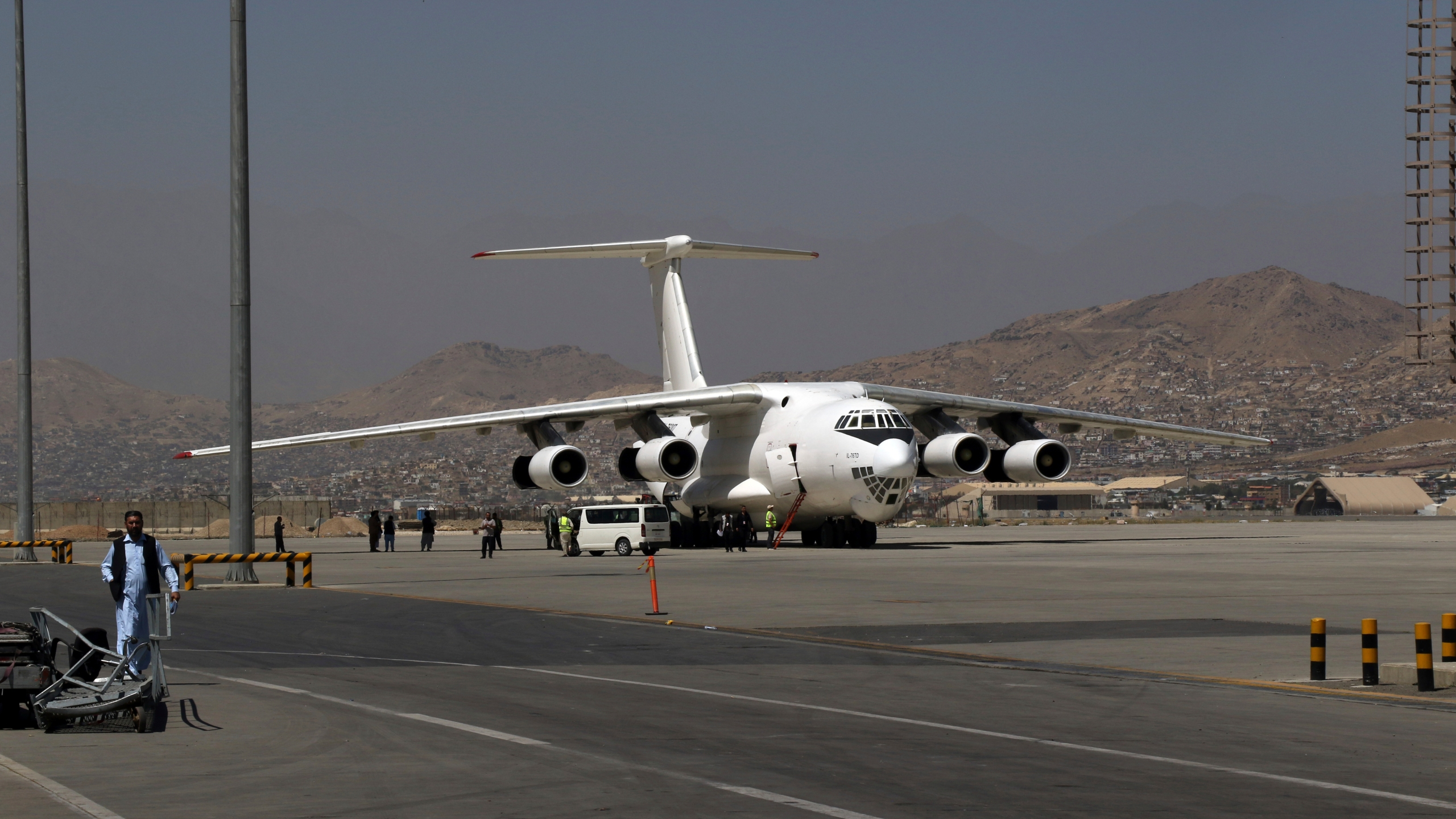 A plane is parked at Hamid Karzai International Airport in Kabul, Afghanistan, Sunday, Sept. 5, 2021. Some domestic flights have resumed at Kabul's airport, with the state-run Ariana Afghan Airlines operating flights to three provinces. (AP Photo/Wali Sabawoon)