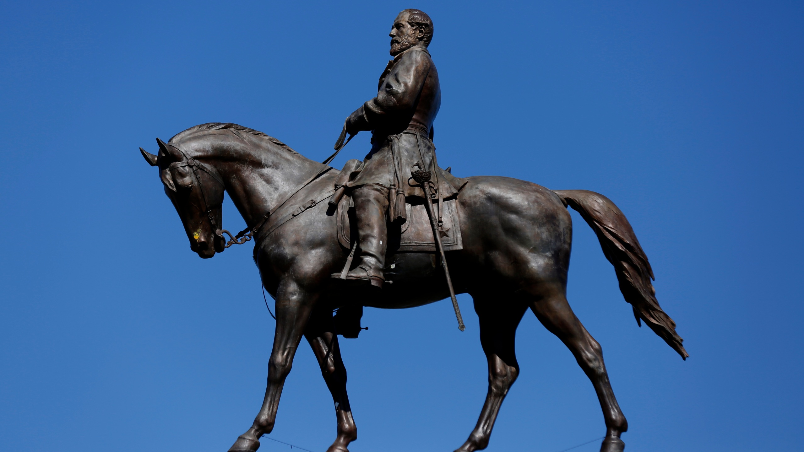 FILE - In this Thursday, Sept. 2, 2021, file photo, the Robert E. Lee Monument is shown in Richmond, Va. The Supreme Court of Virginia has ruled unanimously that the iconic statue of Confederate Gen. Robert E. Lee can be removed from its place of honor in Richmond. (Daniel Sangjib Min/Richmond Times-Dispatch via AP, File)
