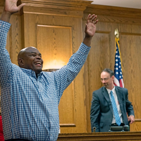 FILE - Dontae Sharpe enters a Pitt County courtroom to the cheers of his family after a judge determined he could be set free on a $100,000 unsecured bond on Thursday, Aug. 22, 2019 in Greenville, N.C. Dozens of people supporting Sharpe, a who served 25 years behind bars for a murder he said he didn't commit, gathered Friday, Sept. 24, 2021, outside the Executive Mansion calling on the governor to formally pardon him now. (Deborah Griffin/The Daily Reflector via AP, File)