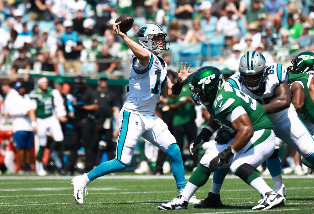 CHARLOTTE, NORTH CAROLINA - SEPTEMBER 12: Sam Darnold #14 of the Carolina Panthers throws a pass during the second quarter against the New York Jets at Bank of America Stadium on September 12, 2021 in Charlotte, North Carolina. (Photo by Grant Halverson/Getty Images)