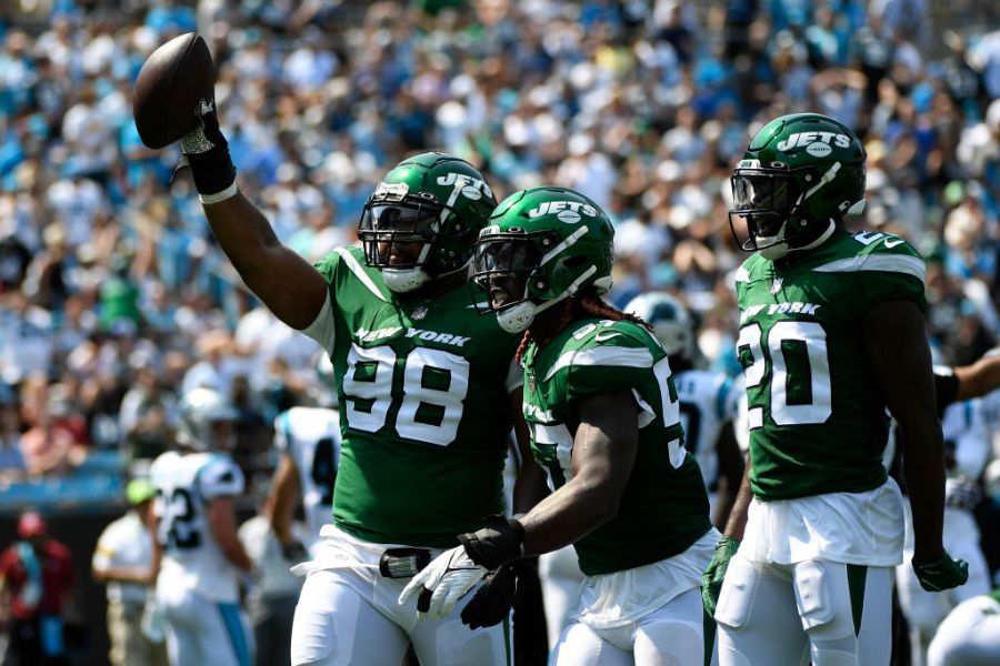CHARLOTTE, NORTH CAROLINA - SEPTEMBER 12: Sheldon Rankins #98 of the New York Jets reacts after recovering a fumble during the second quarter against the Carolina Panthers at Bank of America Stadium on September 12, 2021 in Charlotte, North Carolina. (Photo by Mike Comer/Getty Images)