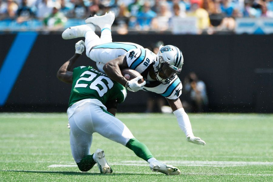 CHARLOTTE, NORTH CAROLINA - SEPTEMBER 12: Terrace Marshall Jr. #88 of the Carolina Panthers is tackled by Brandin Echols #26 of the New York Jets during the first half at Bank of America Stadium on September 12, 2021 in Charlotte, North Carolina. (Photo by Mike Comer/Getty Images)