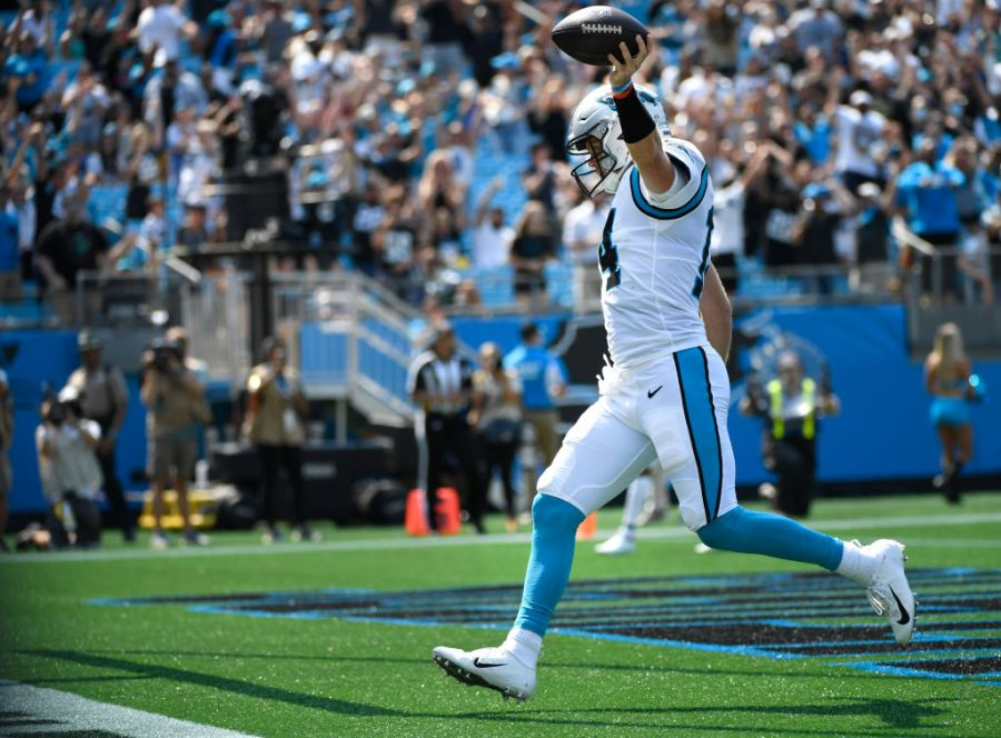 CHARLOTTE, NORTH CAROLINA - SEPTEMBER 12: Sam Darnold #14 of the Carolina Panthers scores a five yard rushing touchdown against the New York Jets during the second quarter at Bank of America Stadium on September 12, 2021 in Charlotte, North Carolina. (Photo by Mike Comer/Getty Images)