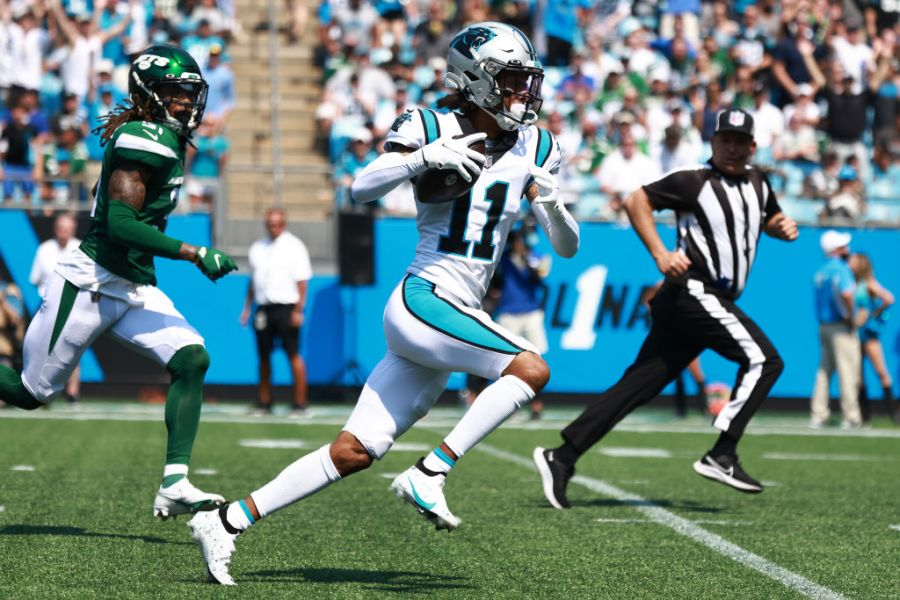 CHARLOTTE, NORTH CAROLINA - SEPTEMBER 12: Robby Anderson #11 of the Carolina Panthers catches a 57-yard pass from Sam Darnold #14 (not pictured) for a touchdown during the second quarter against the New York Jets at Bank of America Stadium on September 12, 2021 in Charlotte, North Carolina. (Photo by Grant Halverson/Getty Images)