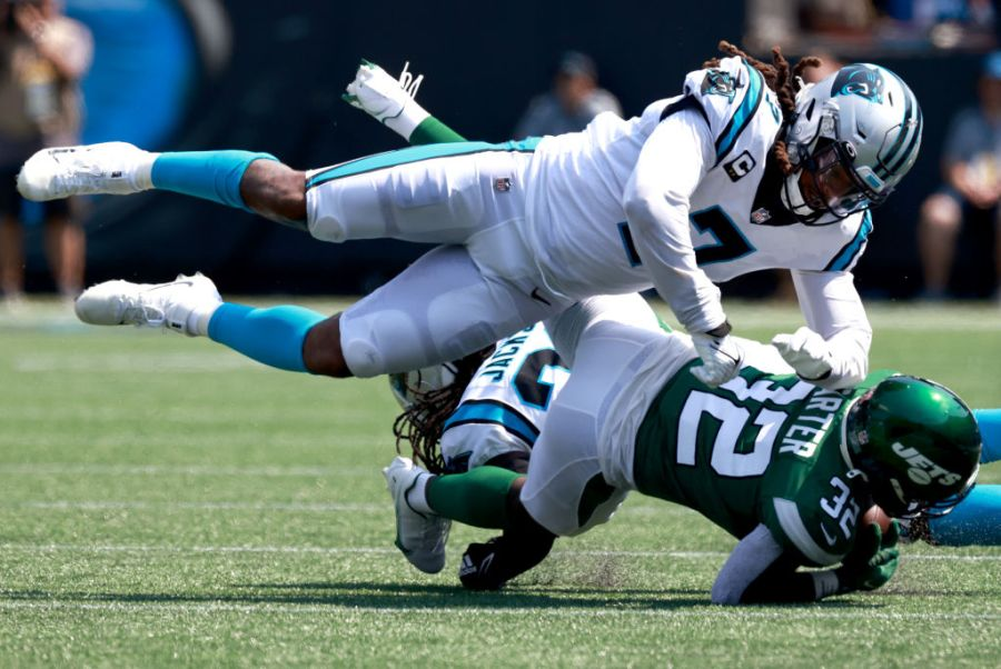 CHARLOTTE, NORTH CAROLINA - SEPTEMBER 12: Shaq Thompson #7 of the Carolina Panthers tackles Michael Carter #32 of the New York Jets during the second quarter at Bank of America Stadium on September 12, 2021 in Charlotte, North Carolina. (Photo by Grant Halverson/Getty Images)
