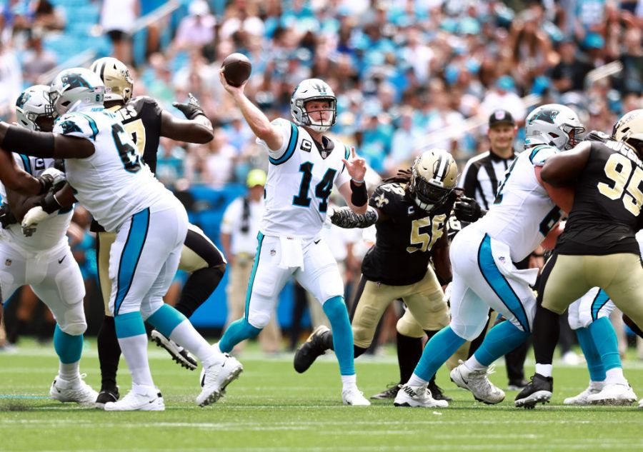 CHARLOTTE, NORTH CAROLINA - SEPTEMBER 19: Quarterback Sam Darnold #14 of the Carolina Panthers throws the ball during the first half in the game against the New Orleans Saints at Bank of America Stadium on September 19, 2021 in Charlotte, North Carolina. (Photo by Grant Halverson/Getty Images)