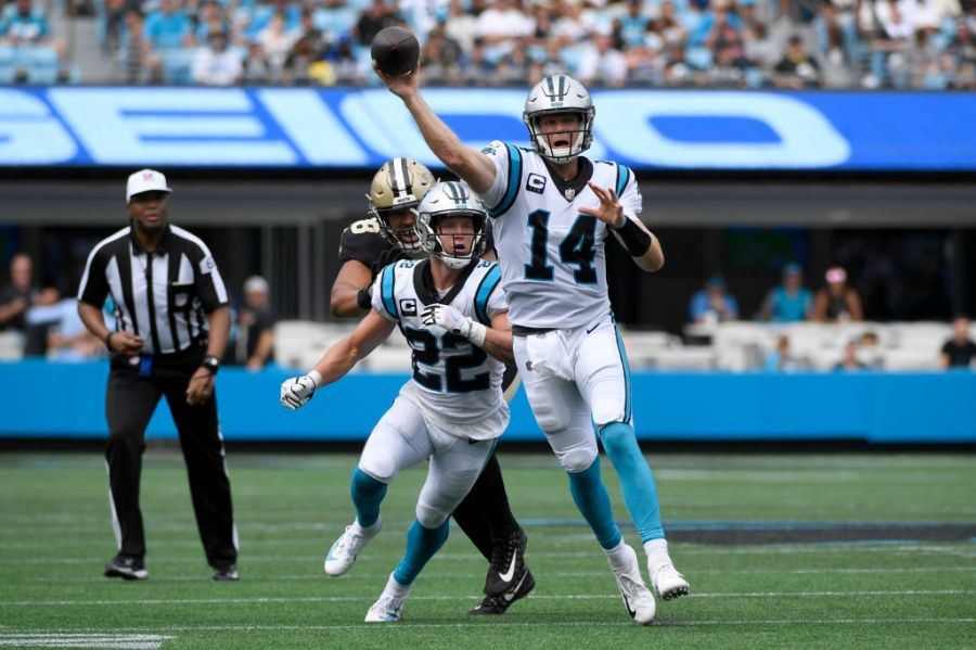 CHARLOTTE, NORTH CAROLINA - SEPTEMBER 19: Quarterback Sam Darnold #14 of the Carolina Panthers throws the ball during the first half in the game against the New Orleans Saints at Bank of America Stadium on September 19, 2021 in Charlotte, North Carolina. (Photo by Mike Comer/Getty Images)