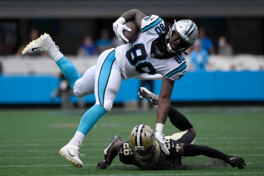 CHARLOTTE, NORTH CAROLINA - SEPTEMBER 19: Tight end Ian Thomas #80 of the Carolina Panthers catches the ball over cornerback P.J. Williams #26 of the New Orleans Saints during the first half at Bank of America Stadium on September 19, 2021 in Charlotte, North Carolina. (Photo by Mike Comer/Getty Images)