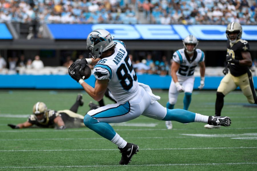 CHARLOTTE, NORTH CAROLINA - SEPTEMBER 19: Tight end Dan Arnold #85 of the Carolina Panthers catches the ball during the first half in the game against the New Orleans Saints at Bank of America Stadium on September 19, 2021 in Charlotte, North Carolina. (Photo by Mike Comer/Getty Images)