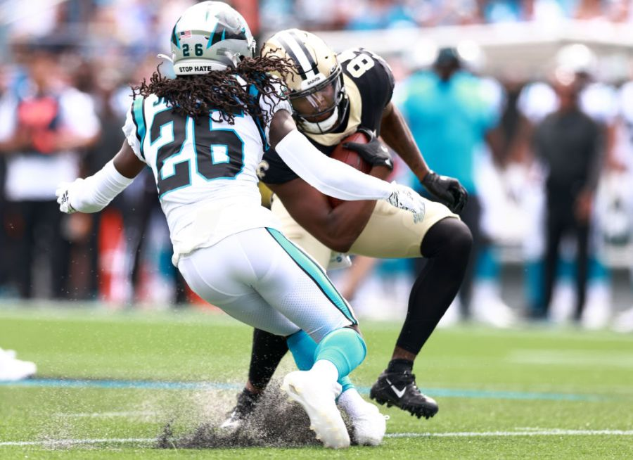 CHARLOTTE, NORTH CAROLINA - SEPTEMBER 19: Wide receiver Lil'Jordan Humphrey #84 of the New Orleans Saints looks to avoid a tackle by cornerback Donte Jackson #26 of the Carolina Panthers at Bank of America Stadium on September 19, 2021 in Charlotte, North Carolina. (Photo by Grant Halverson/Getty Images)