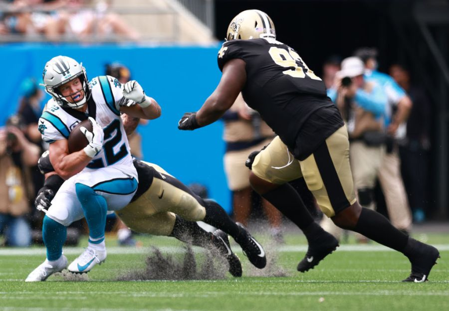 CHARLOTTE, NORTH CAROLINA - SEPTEMBER 19: Running back Christian McCaffrey #22 of the Carolina Panthers runs the ball during the second half in the game against the New Orleans Saints at Bank of America Stadium on September 19, 2021 in Charlotte, North Carolina. (Photo by Grant Halverson/Getty Images)