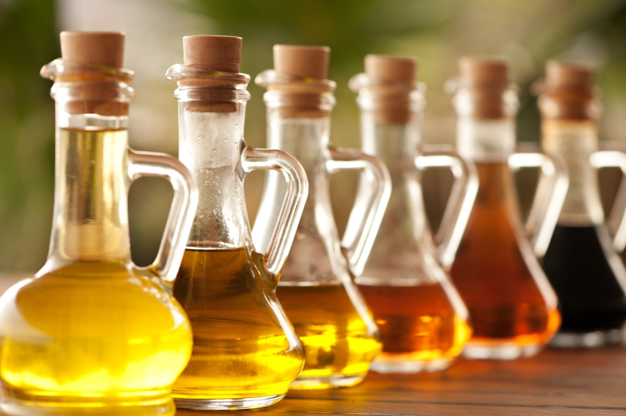 various types of vinegar in glass bottles (Getty Images)