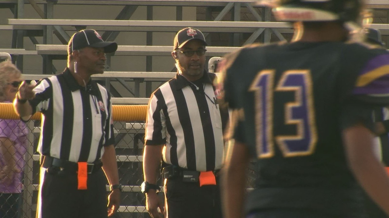 Football referees trapped in locker room as door blocked with vending machine; charges filed