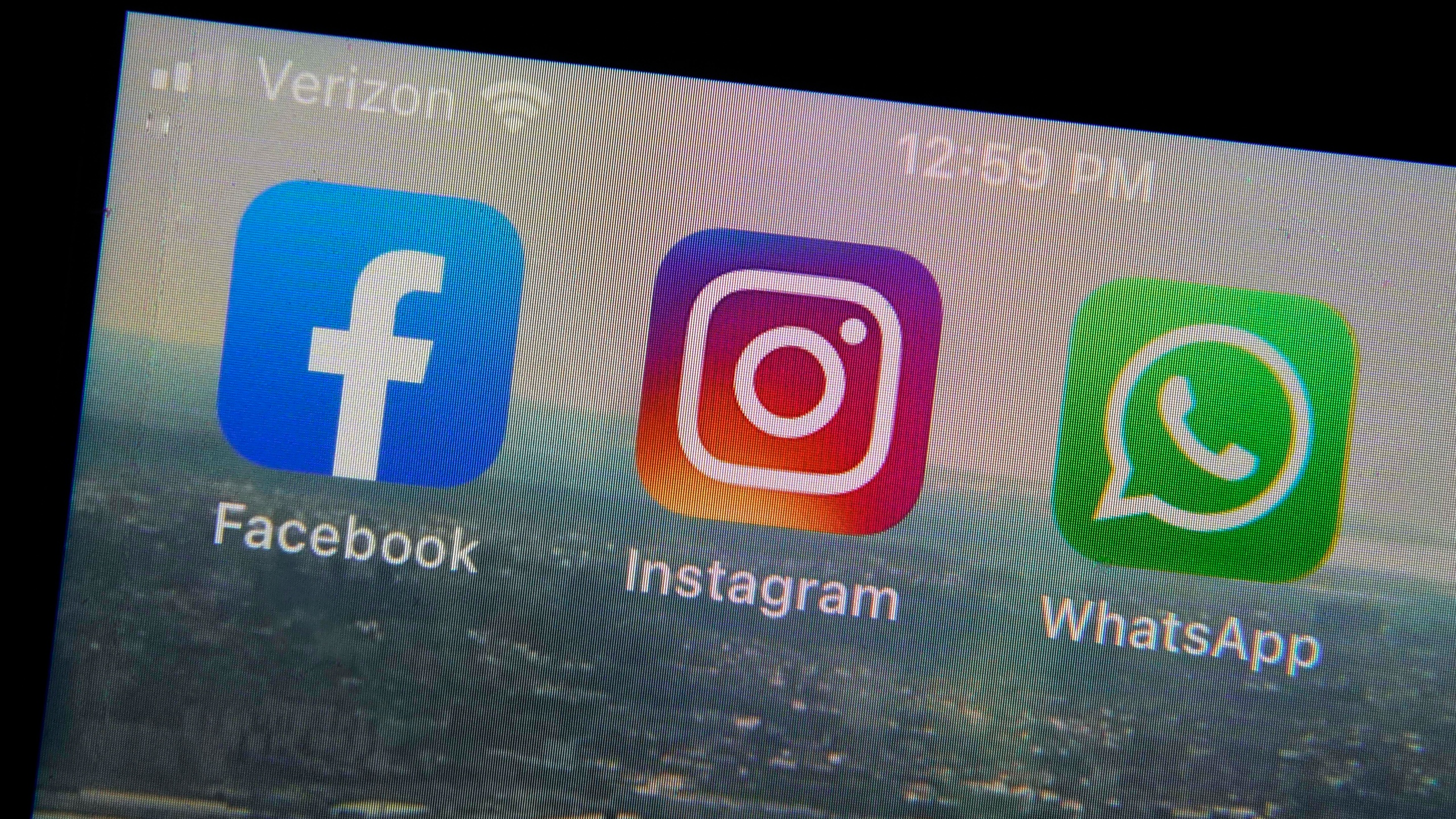 This photo shows the mobile phone app logos for, from left, Facebook, Instagram and WhatsApp in New York, Tuesday, Oct. 5, 2021. The six-hour outage was a headache for many casual users but far more serious for the millions of people worldwide who rely on the social media sites to run their businesses or communicate with relatives, fellow parents, teachers or neighbors. (AP Photo/Richard Drew)