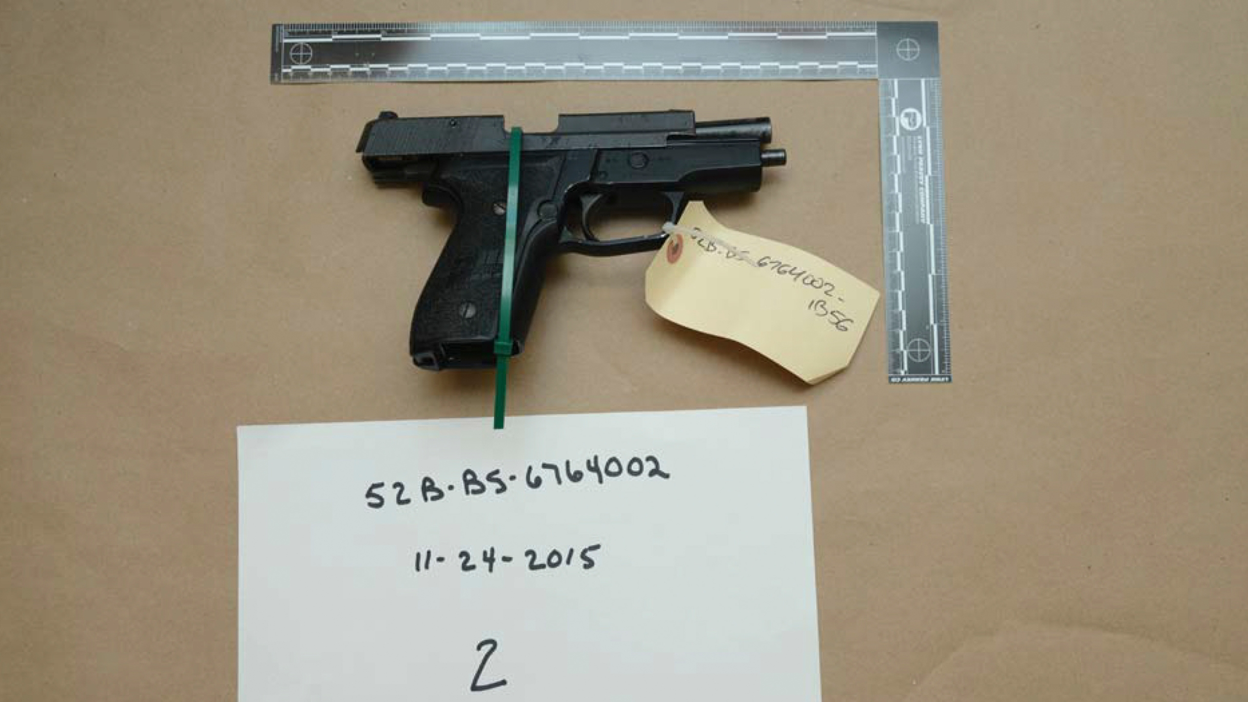 FILE - This evidence photo from the criminal complaint of the U.S. District Court for Massachusetts v. Ashley Bigsbee for illegal possession of a stolen firearm on Nov. 15, 2015, in Suffolk, Mass., shows one of ten M11 semiautomatic handguns that former Army Reserve member James Morales stole from the Lincoln Stoddard Army Reserve Center in Worcester, Mass. Overall, AP has found that at least 2,000 firearms from the Army, Marines, Navy or Air Force were lost or stolen during the 2010s. (U.S. District Court for Massachusetts via AP)