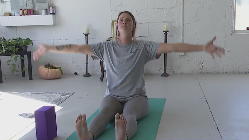 Lexington mom who used yoga to get through some tough times opens studio to help others