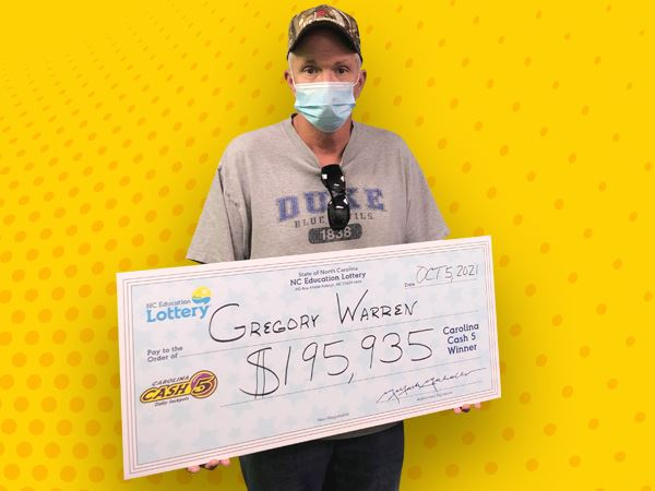 Randolph County mechanic wins half of Cash 5 jackpot, plans to build business with his son