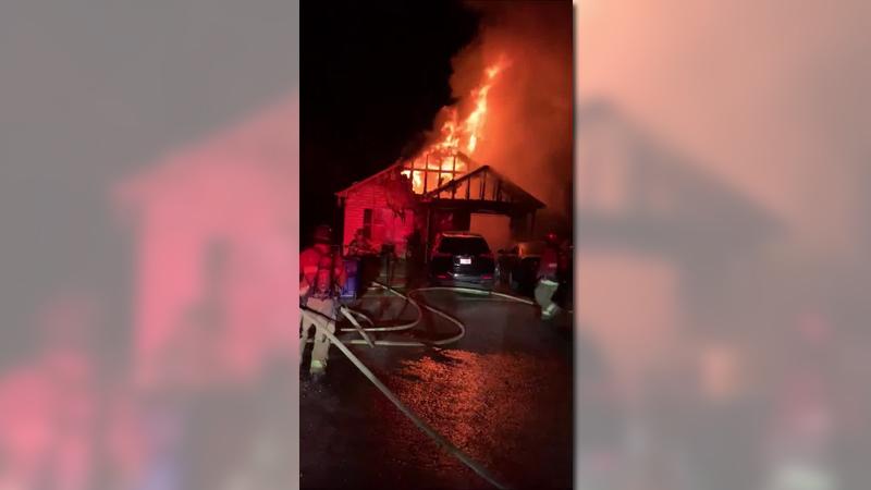 Crews battle raging house fire on Lomond Court in Winston-Salem