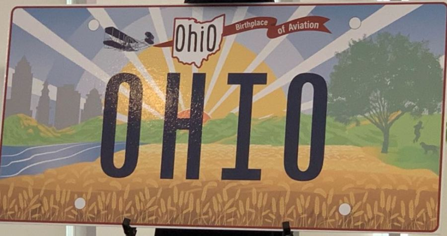 Ohio's new standard license plate, announced Oct. 21, 2021, with the Wright Flyer facing backward. (WJW-TV Photo)
